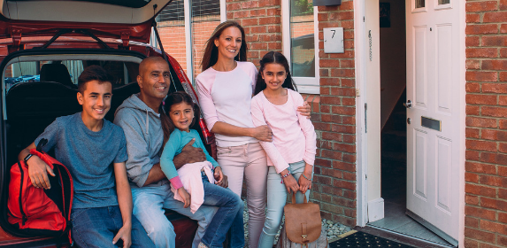 Family-ethnic-diverse-home-leaving-packed-moving-canva photo-can reuse