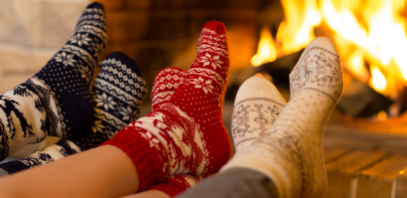 winter-cozy-socks-fire-warm-christmas-family-together-canva photo-can reuse