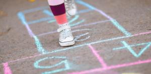 child-playing-hopscotch